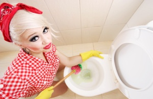 Sexy girl cleaning toilet